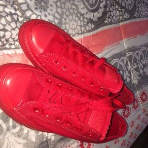 All red low top Converse